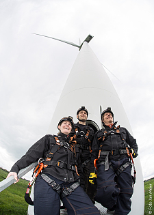 Employees in front of wind turbine